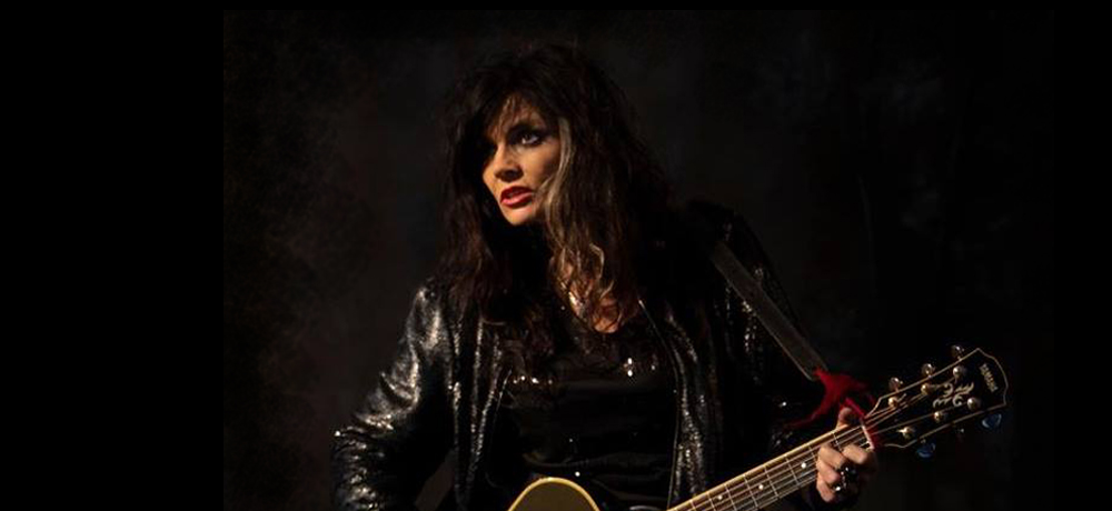 Wendy Rule playing guitar